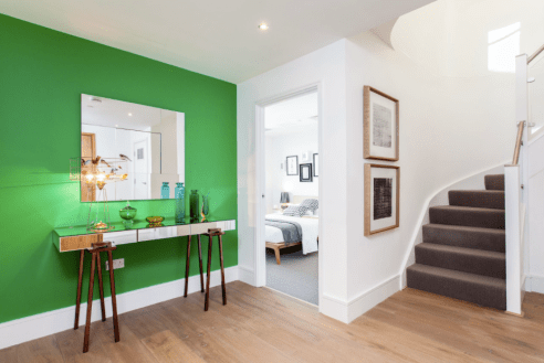 For a modern space try a bright green like Benjamin Moore Kelly Green.