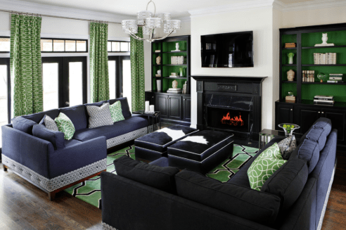 Want to make a statement? Emerald green and navy blue make a stunning pair with black trim and light walls.