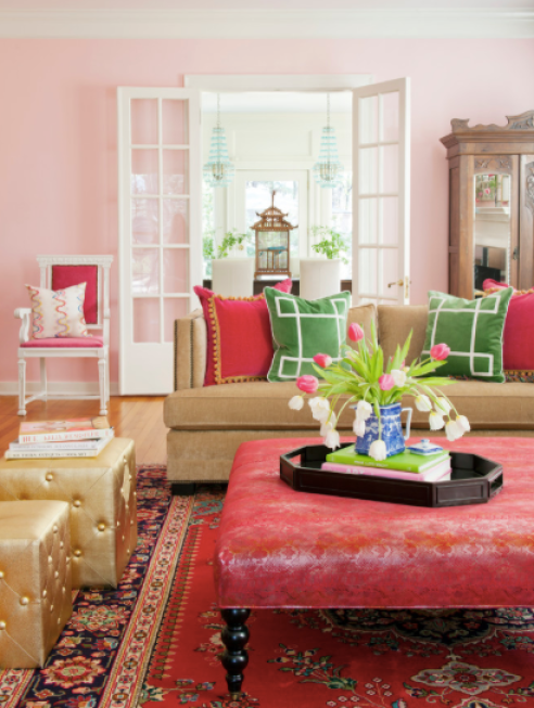 We love the oriental feel in this cheerful pink living room. Green pillows and fresh flowers make great accents.