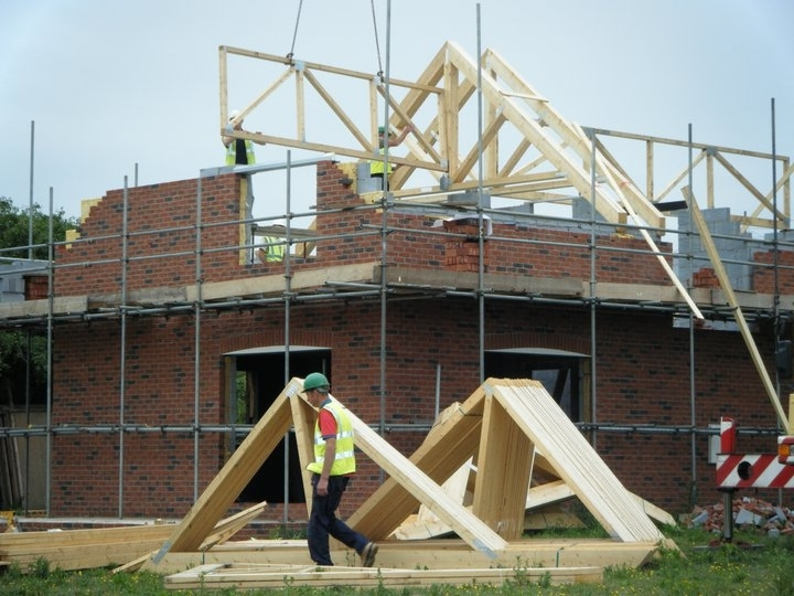 S New House 2. During Construction. Installation of roof trusses.