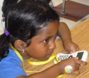 Intensely focused student participating in class using the Response System