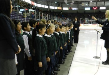 RMS Choir singing the Canadian National Anthem at an OHL Hockey game