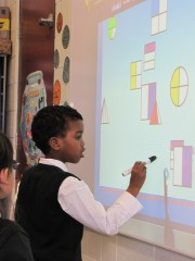 A student immersed in learning using an Interactive Projector