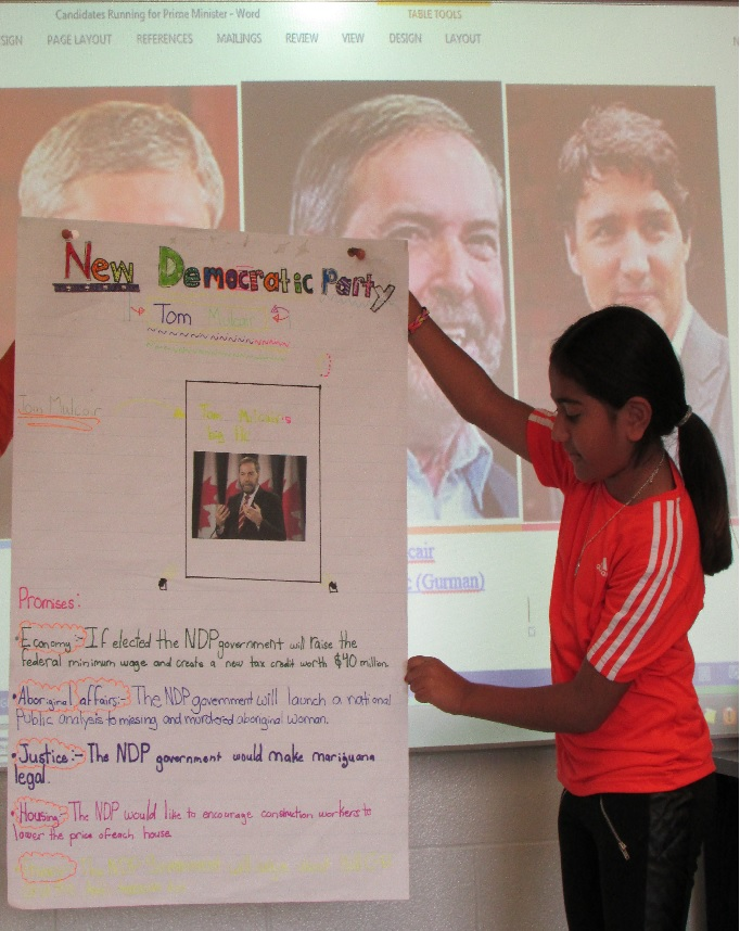 A student presenting her research