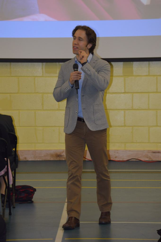 Craig Kielburger speaking at the conference