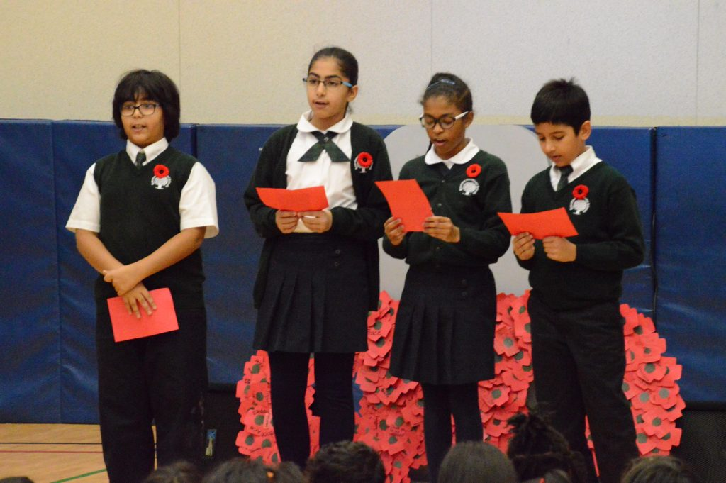 "Students reading ""In Flanders Field"""