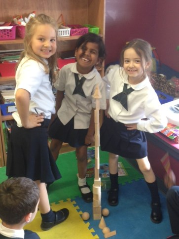 Students having fun at their private school with blocks, showcasing a different learning method