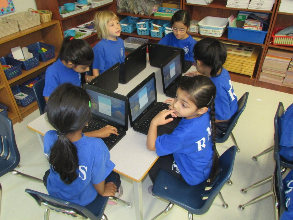 Students working together with technology