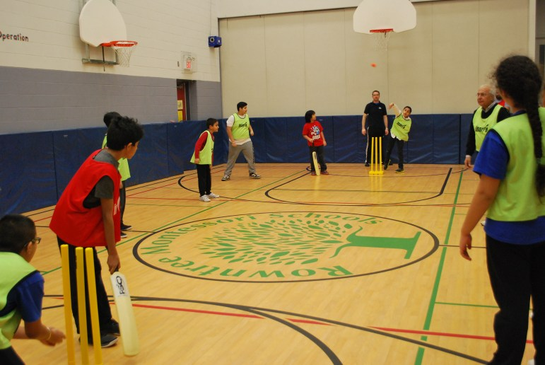 Students at RMS - the Top Private School in Brampton - playing cricket