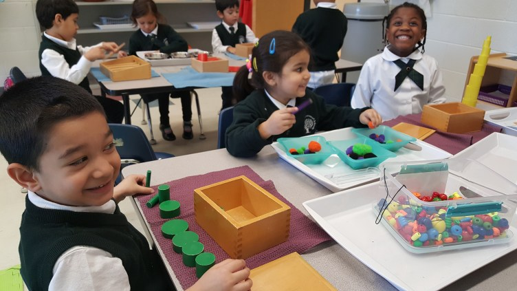 Kindergarten students using Montessori materials