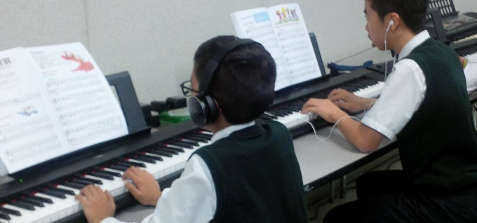 Students playing keyboard in music class at RMS
