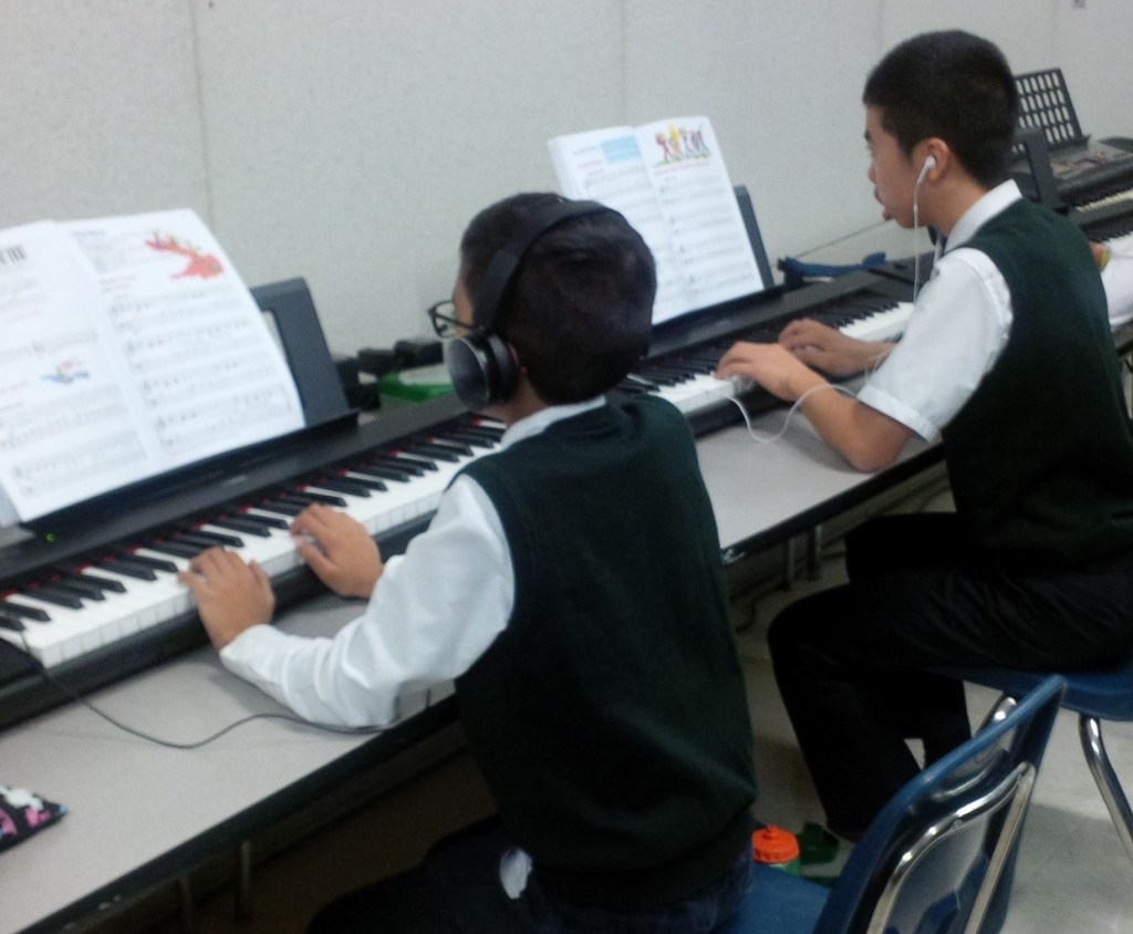 Students playing keyboards at Music class at Rowntree Montessori Schools