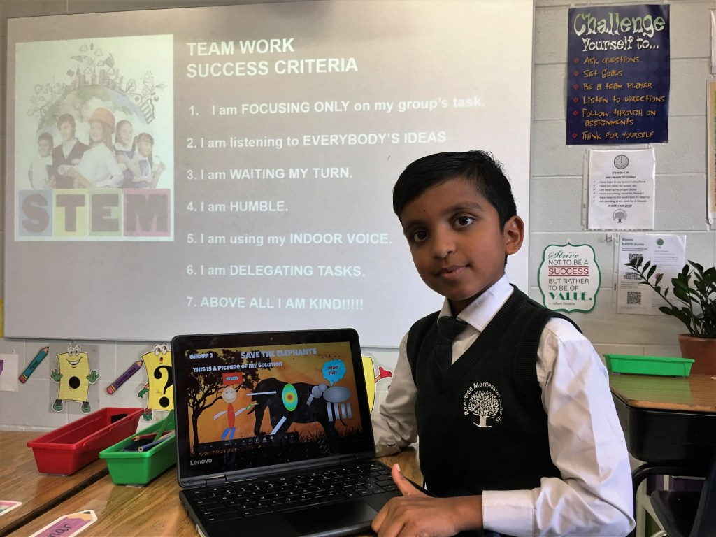 A grade 3 student making a presentation to his class