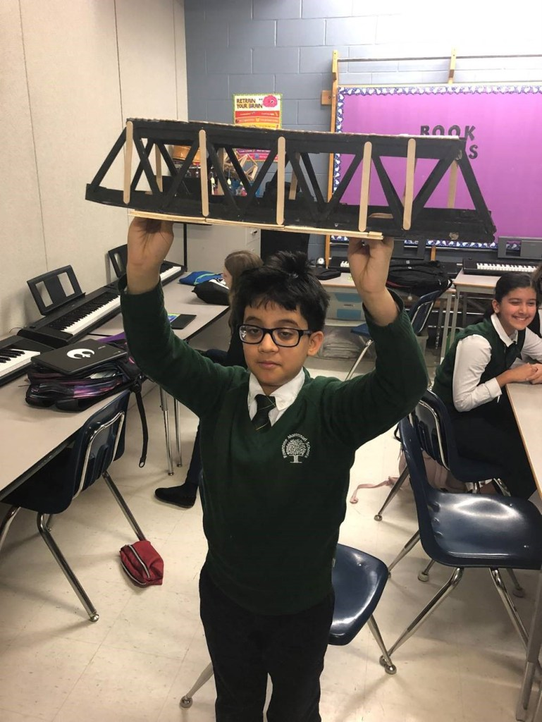 A student with his truss bridge