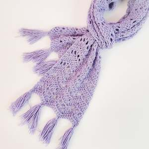 I finally stitched up my sparkly KnitCrate. No pattern, just made it up as I went. I love my new scarf!