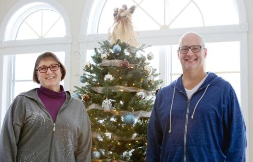 Patrick and Annette Schultz stand with their Christmas tree Friday, Dec. 18, 2015, in their Fargo home. The tree was ordered the same day Patrick suffered his cardiac arrest. Michael Vosburg / Forum Photo Editor