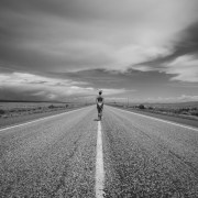 photo of woman standing in the middle of the road, by Roxanne Darling