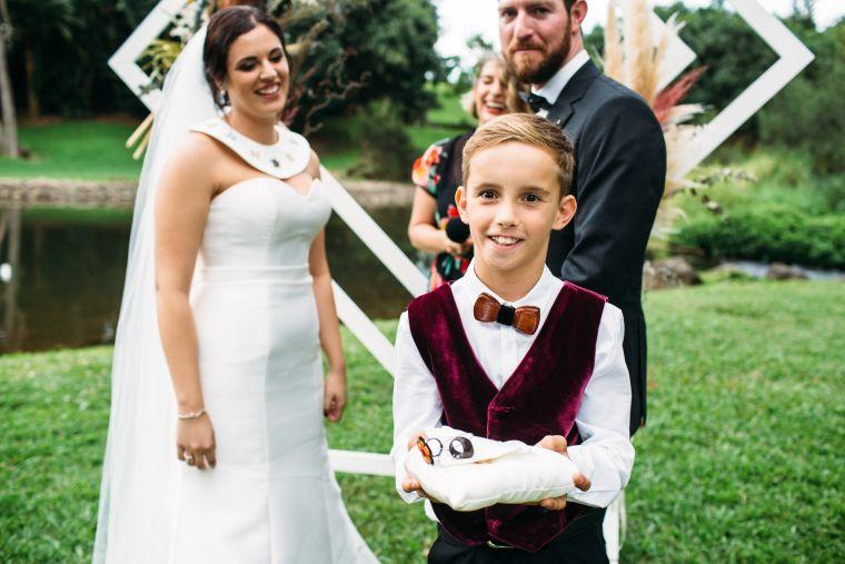 Child presenting alternative wedding rings to bride and groom.  Photo by Wildflower Weddings.  Celebrant Roxy Hotten Celebrant.
