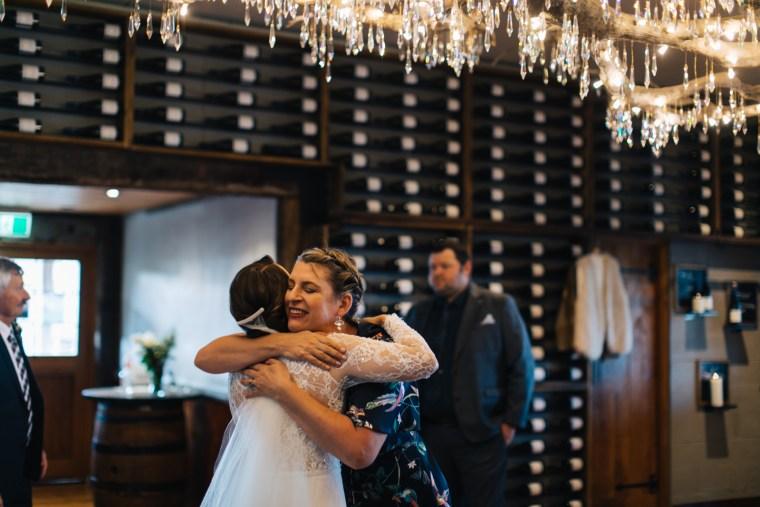 Brisbane Celebrant Roxy hugging bride at Preston Peak winery Toowoomba