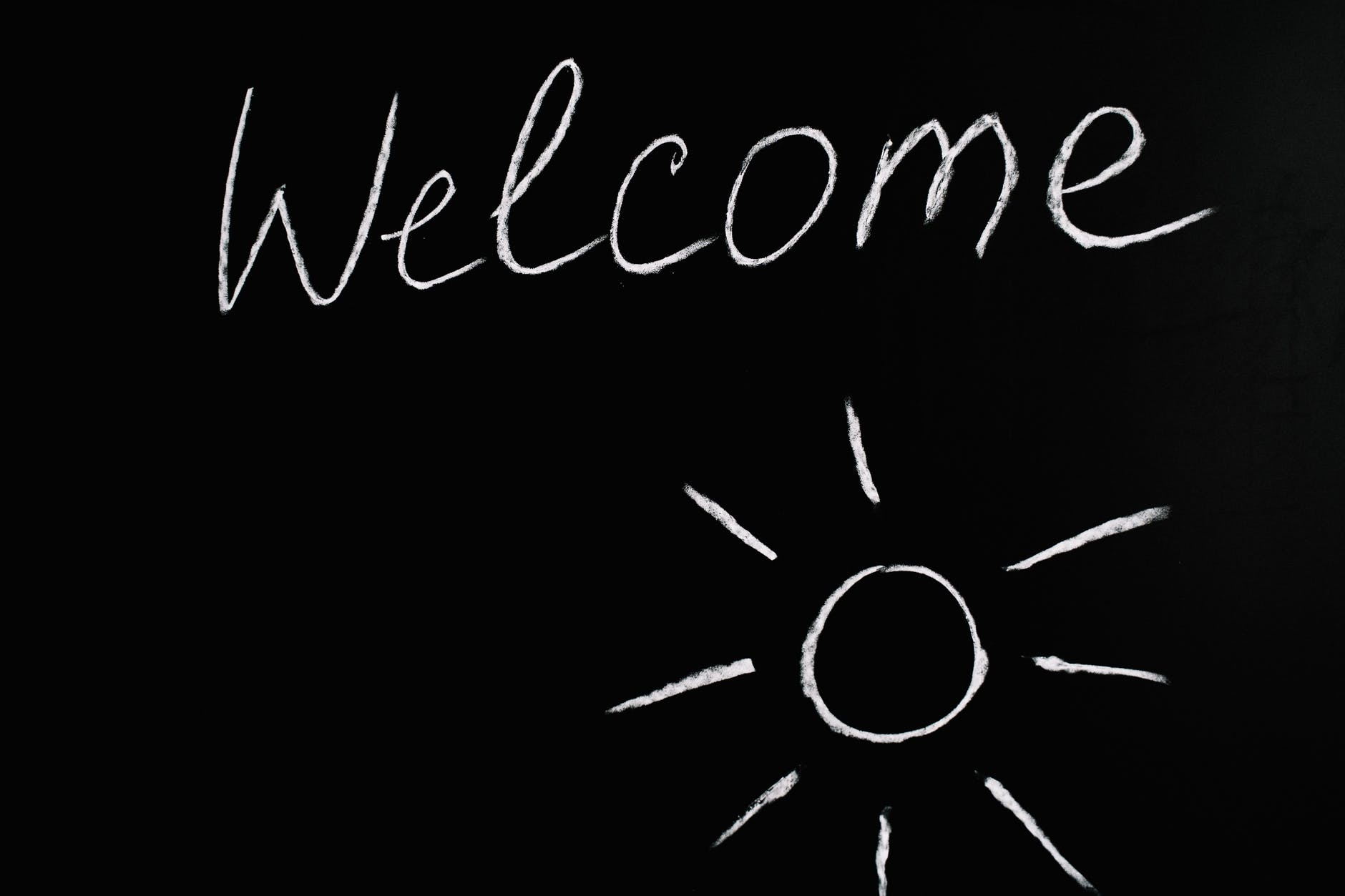 welcome lettering text on black background