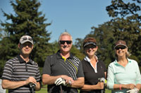 Royal LePage Coast Capital Realty charity golf tournament participants, left to right: Callum Greig, Prime Mortgage Works (gold sponsor), Larry Sims, licensed assistant, Sharen Warde, sales representative and event chair, and guest Dalyn Campbell.