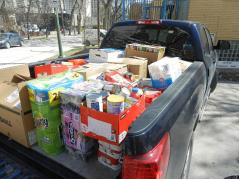 A pickup truck is loaded with much needed non-perishables collected by Royal LePage Top Producers in Winnipeg, Manitoba and destined for two local women's shelters.