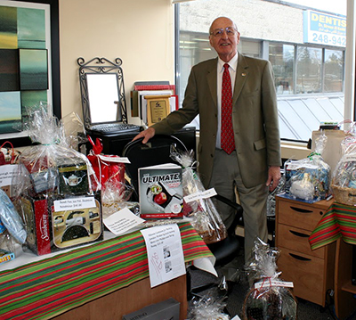 """Royal LePage Performance Realty branch manager John Rogan shops in the """"Auction Store."""""""