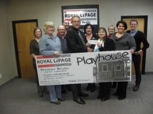 Warren Vandenameele, broker/owner of Royal LePage Premier Realty and team present $3,1900 in proceeds to LaVern Dumka of Shelwin House