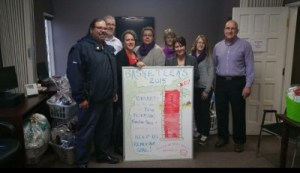 Royal LePage Lannon Realty collected gifts for women and children staying at local shelters. Pictured from left to right:  Sam Costantino of AMJ Campbell Van Lines, Andrew Lawrence (office manager), Sari Jamsa Babcock (sales representative), Debra Verment of Beendigen, Kathy Barton of Faye Peterson, Darlene Dundas (office administrator), Coral McCaul of Faye Peterson and Mark Ambrose of Beendigen.