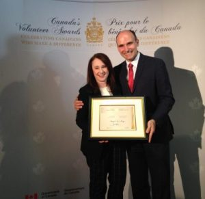 The Honourable Jean-Yves Duclos, Minister of Families, Children and Social Development presents the award in Ottawa to Shelter Foundation Executive Director, Shanan Spencer-Brown.