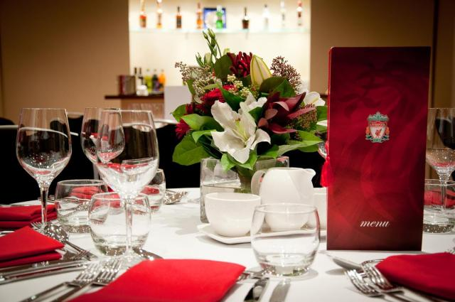 Dutch flower shop Liverpool red and white themed floral centrepieces for Liverpool football Club event.
