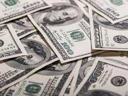 Dollar holds tight ahead of key U.S. jobs data