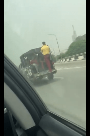 LASTMA official called out for breaking the law by standing at the back of a moving truck (video)