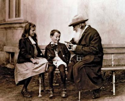 Tolstoy with his grandchildren, around the same time he recalled the story of the little green stick.