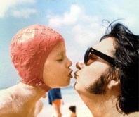 Roy and Roy Orbison Jr kissing at the beach