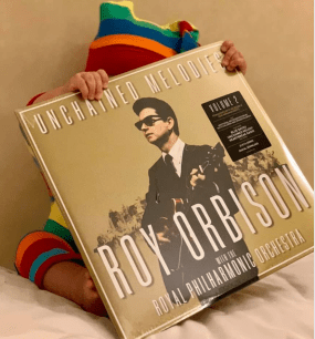 "Bo Orbison with his copy of Roy Orbison's album ""Unchained Melodies"""