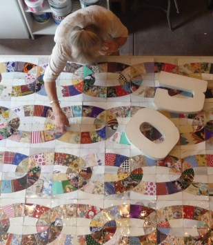 "Janet De Berge Lange at work in her studio on ""No,"" a traditional quilt pattern made from untraditional materials"