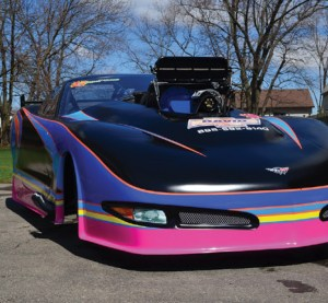 A pink, blue, and black drag racing car