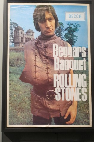 """Ultr-rare promotional ad image for """"Beggars Banquet."""" Why is Charlie missing an arm? Perhaps he is begging for it back?"""