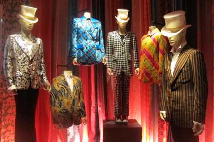 """Far right: Mick's striped suit that can be seen in a few '73 press conference pics and magazine spreads while the Stones toured Europe in '73; In the middle is the black and white checked suit Mick wore often during the '69 tour and trip to America; it pops up in several Ethan Russell photos of the Stones staying at Stephen Stills' house in Laurel Canyon in L.A. while preparing for the U.S. tour, as well as a dress rehearsal for the """"Ed Sullivan Show"""" that fall (where they performed """"Gimme Shelter"""" and """"Love In Vain"""")"""