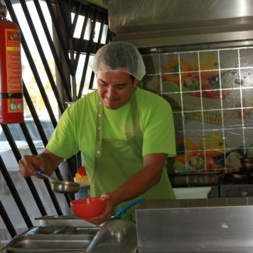 [Alfonso serving Soup] The Healthy Kitchen serves lunch and dinner, offers delivery to your home or office, and does catering for events large and small.