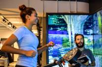 Woman Smiling in front of RPV display in Nike Soho