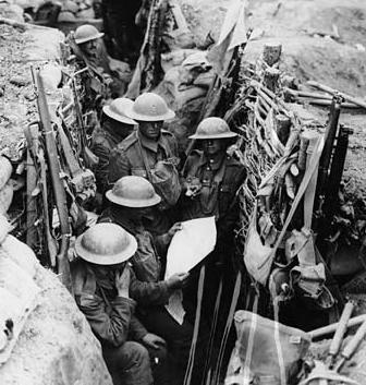 Reading the news in the trenches 1000 yards from enemy lines. No known copyright restrictions: National Library of Scotland.