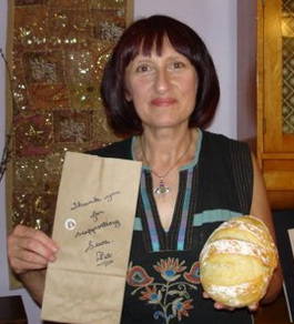"""The brown paper bag reads, """"Thank you for your support of Seva. Pat"""""""