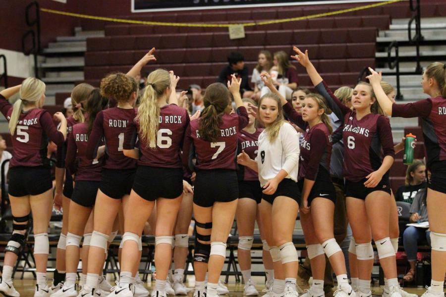 Lady+Dragons+huddle+in+a+timeout+during+second+set+of+Vista+Ridge+game