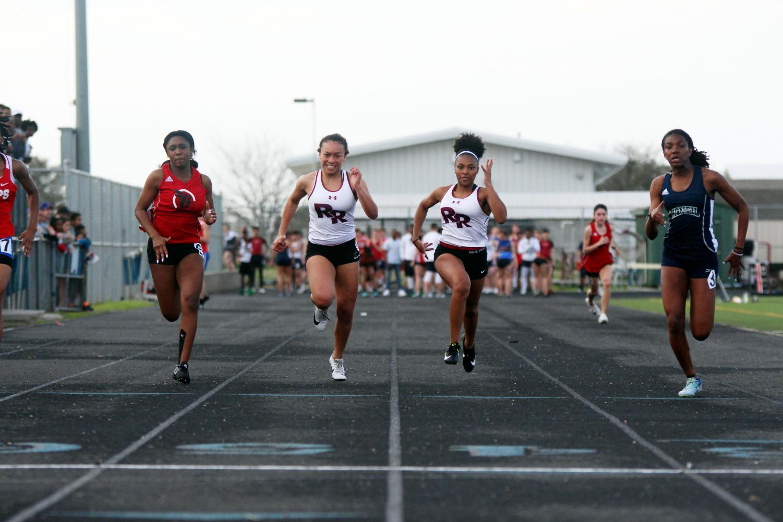 Jade Jordan and Ti'anna Goodlow racing to the finish in the 100 meter dash.