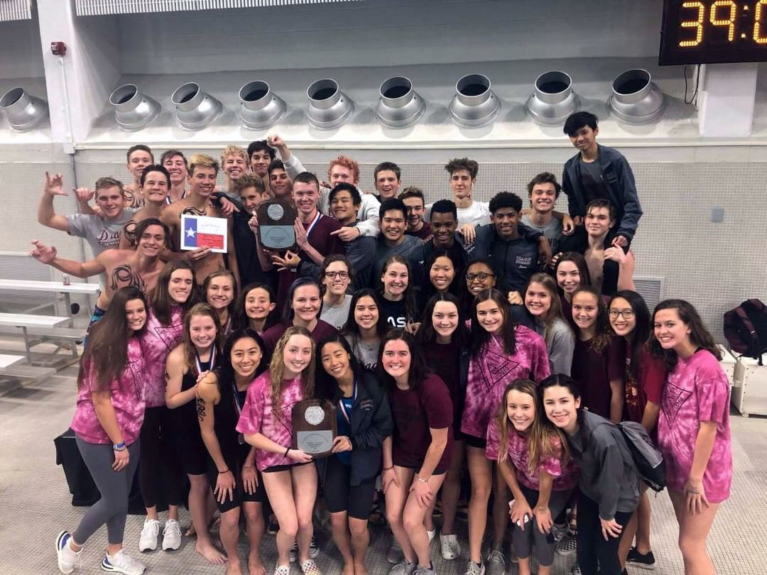 Round Rock swim team celebrates after boys win the district title and girl win runner up.