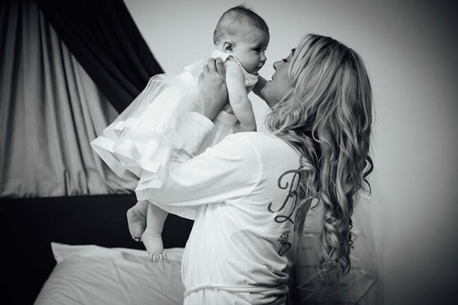 Bride holding her baby