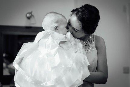 Bridesmaid kissing baby sister