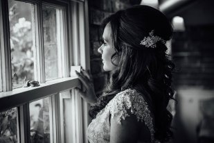 Bridal portrait looking out the window